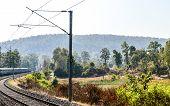 Train Journey In India On A Mesmerizing Railway Tracks In Konkan Railway. Scenic Train Running In De poster
