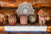 Easter Wooden Eggs Into National Old Russian Patterns And A Straw Toy Stands On A Wooden Shelf Decor poster