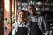 Happy Diverse Waiter And Waitress Looking At Camera In Restaurant poster