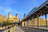 Paris France City Skyline Sunrise At Seine River And Pont De Bir-hakeim Bridge With Paris Metro poster