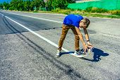Boy Draws On The Road With Toilet Paper, Surreal Photo. poster