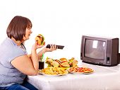 stock photo of take out pizza  - Big woman eating fast food and watching TV - JPG