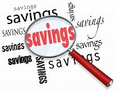 A magnifying glass hovering over several instances of the word Savings, a symbolic representation of