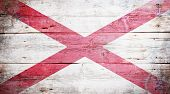 image of alabama  - Flag of Alabama painted on grungy wooden background - JPG