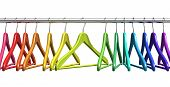 image of housekeeper  - Row of color rainbow coat hangers on metal shiny clothes rail isolated on white background - JPG