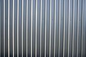 Corrugated Metal Sheet Fence With Natural Grainy Texture