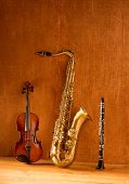 image of clarinet  - Classic music Sax tenor saxophone violin and clarinet in vintage wood background - JPG