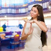 Portrait Of Young Woman Showing Time Out Signal in a restaurant