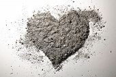 stock photo of ashes  - Grey love heart made of ash and dust - JPG