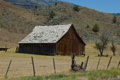 picture of sagebrush  - Old wooden barn amidst sagebrush hills of central Oregon - JPG