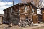 picture of blacksmith shop  - Blacksmith shop with a horseshoe shaped sign in the ghost town of Nevada City Montana - JPG