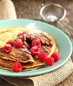 image of crepes  - Crepes With Fresh Raspberry And Powder Sugar - JPG