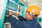 electrician at work checking wire with drawing inspecting high voltage power electric line distribut
