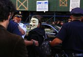 Mask wearing marcher arrested