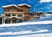 stock photo of chalet  - Mountain ski resort with snow in winter - JPG