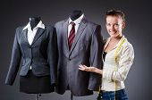 stock photo of dress mannequin  - Woman tailor working on clothing - JPG
