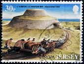 JERSEY - CIRCA 1994: Stamp printed in Jersey shows La Hougue Bie discovered 1924 circa 1994