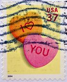 An I love you stamp printed in the USA shows two hearts