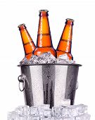stock photo of humidity  - Beer bottles in ice bucket isolated on white - JPG