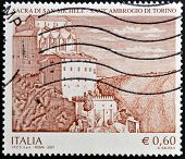 A stamp printed in Italy shows the gothic abbey Sacra di San Michele Sant'Ambrogio near Turin