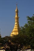 stock photo of yangon  - The golden tip of Sule Pagoda in Yangon Myanmar  - JPG