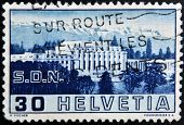 SWITZERLAND - CIRCA 1938: a stamp printed in Switzerland shows Palace of League of Nations Geneva