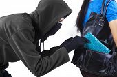 image of dangerous situation  - Thief stealing a wallet from handbag of a woman - JPG