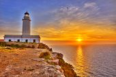 stock photo of mola  - La Mola Cape Lighthouse Formentera at sunrise in Balearic Islands - JPG