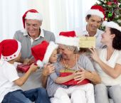 Happy Family With Christmas Gifts At Home