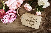 stock photo of appreciation  - Mothers day card with rustic roses on wooden board - JPG