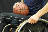 foto of physically handicapped  - Wheelchair basketball player with ball on his lap - JPG