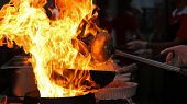 pic of flames  - Professional chef in a commercial kitchen cooking flambe style - JPG