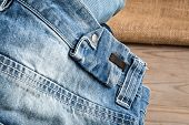 picture of jeans skirt  - In the picture we can see blue jeans and their various parts and components and many details - JPG