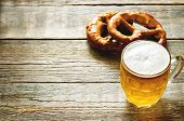 picture of pretzels  - beer and pretzel on a dark wood background - JPG