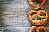 pic of pretzels  - pretzels on a dark wood background - JPG