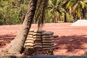 pic of deforestation  - a pile of cement sacks in a deforestated area in the thailand countryside - JPG
