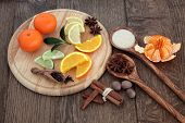 stock photo of satsuma  - Mulled wine ingredients of citrus fruit and spices over oak background - JPG