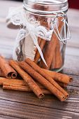 picture of cinnamon  - Cinnamon on dark wooden background - JPG
