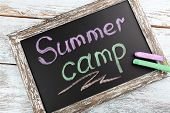pic of sticks  - Text Summer camp written with chalk on chalkboard - JPG