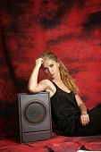 picture of subwoofer  - The girl with a subwoofer on a red background - JPG