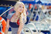 foto of flowing hair  - Beautiful blonde with blue eyes and long flowing hair - JPG