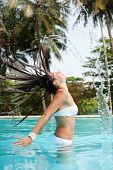 Woman With Wet Hair In The Pool