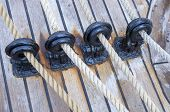 stock photo of pulley  - the wooden sailboat pulleys and ropes detail - JPG