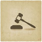 stock photo of court hammer  - judge or auctioneer hammer old background  - JPG