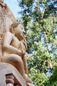picture of garden sculpture  - beige sculpture buddha statue in the garden - JPG