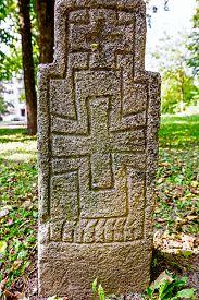 stock photo of headstones  - Gravestone made of headstone with Maltese cross craved in - JPG