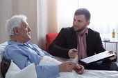 pic of older men  - Older dying man in hospital talking with his notary
