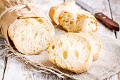 stock photo of french culture  - French Baguette baked food on white rustic table - JPG