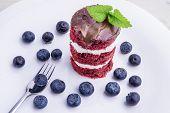 pic of red velvet cake  - Red velvet cake with blueberries - JPG