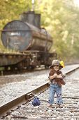 picture of railroad car  - Adorable toddler on the railroad tracks dressed as a little hobo - JPG
